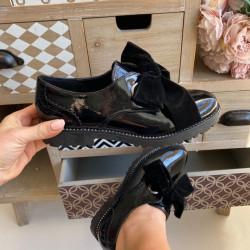 Melnas lakādas kurpes